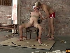 Ross gets blindfolded and tied to a chair and made to cum