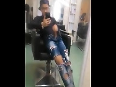 Southeast Asian boy wearing hole jeans at barber shop