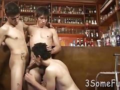 Two mates gangbang the third guy on the barstool
